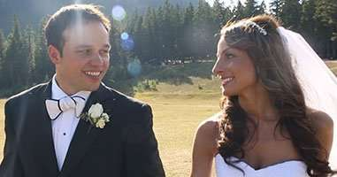 Calgary wedding videographer films couple walking hand in hand