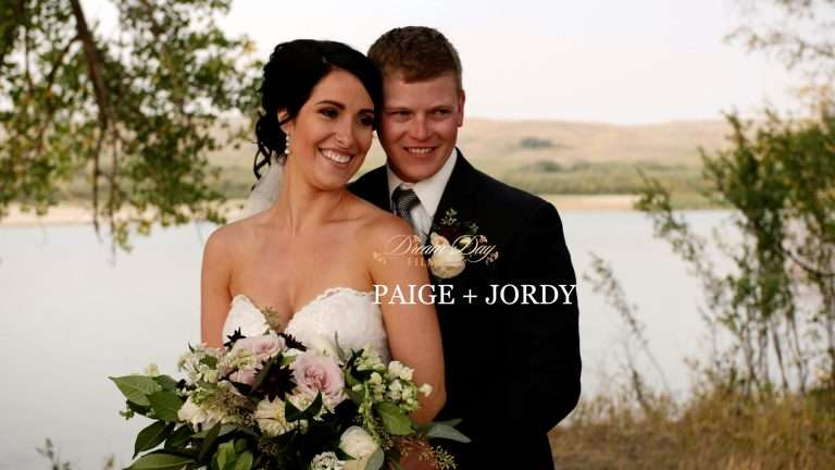 Paige and Jordy hold each other by the Red Deer River