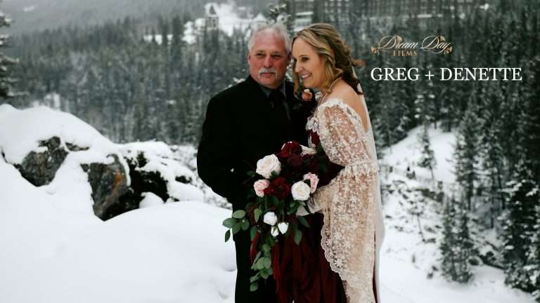 Image of Denette and Greg holding each other with Banff springs hotel in the background