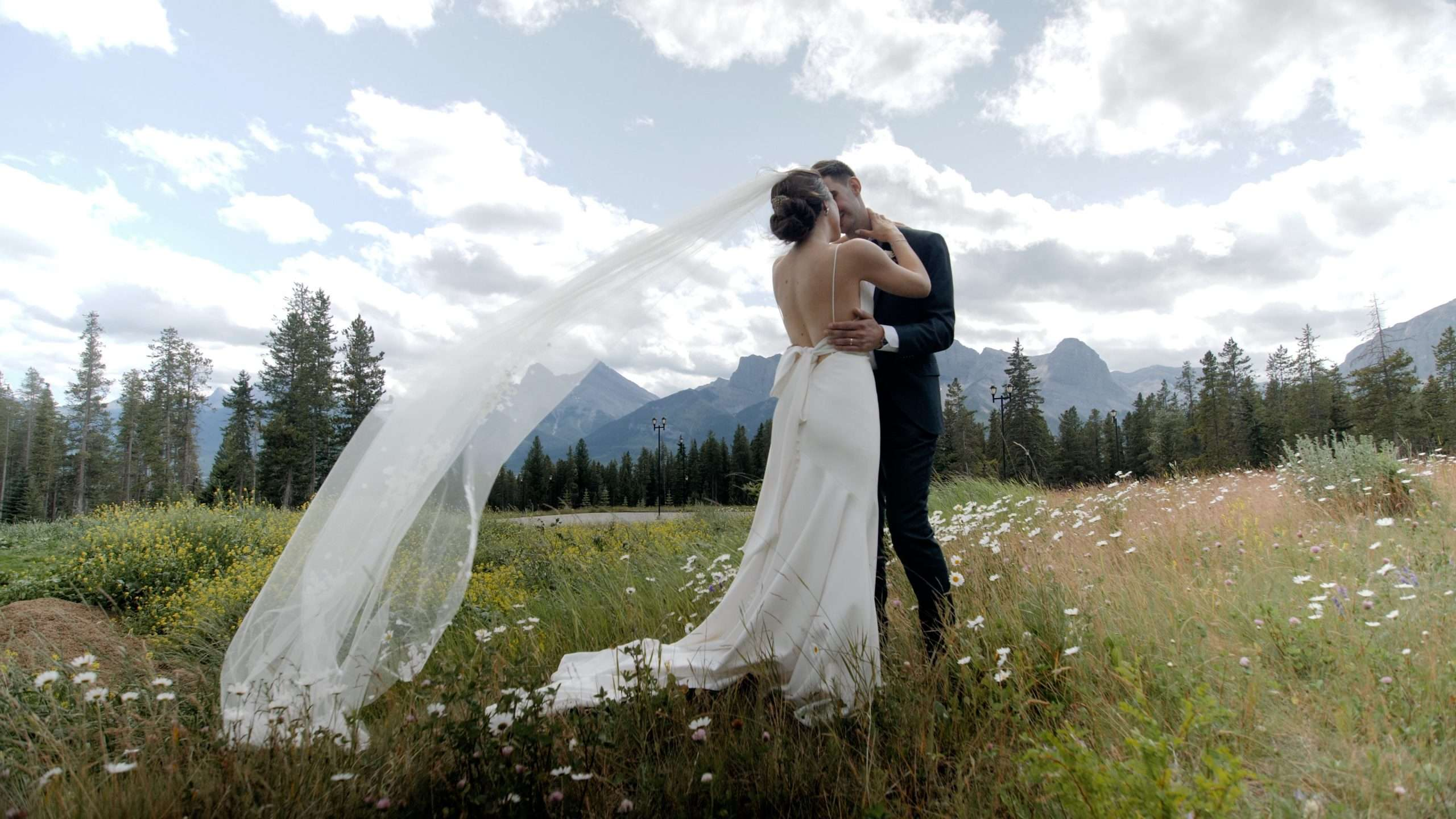 Wedding webpage cover image of Audrey and Martin holding each other at Silvertip in Canmore